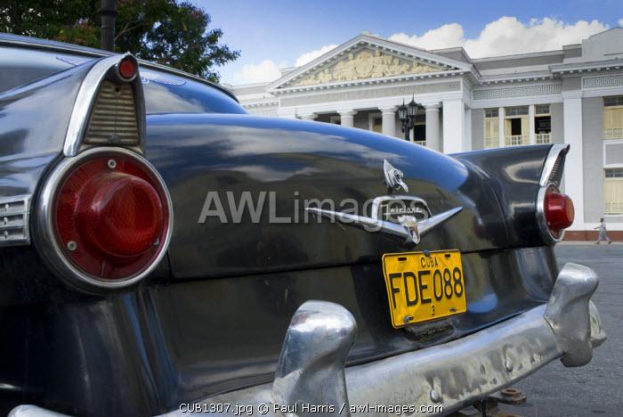 Cuba, Cienfuegos. Vintage American car, Jose Marti Plaza, Cienfuegos