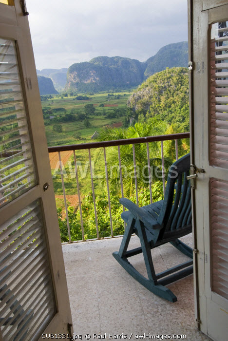 Cuba, Vinales. View across the Vinales Valley from Hotel Jazmines. The Viñales Valley has been on UNESCO's World Heritage List since November 1999 as a cultural landscape enriched by traditional farm and village architecture. Old-fashioned farming methods are still used in Viñales, notably to grow tobacco. The local population is an ethnic mix that illustrates the cultural development of the Caribbean and Cuba in particular.