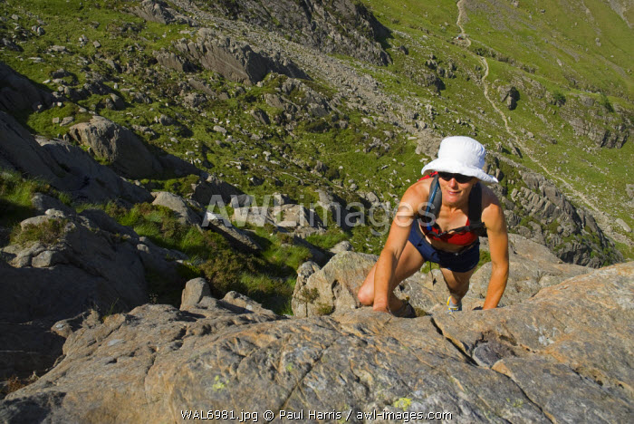 North Wales, Snowdonia. Active woman walking and climbing in the Ogwen Valley, Snowdonia, North Wales