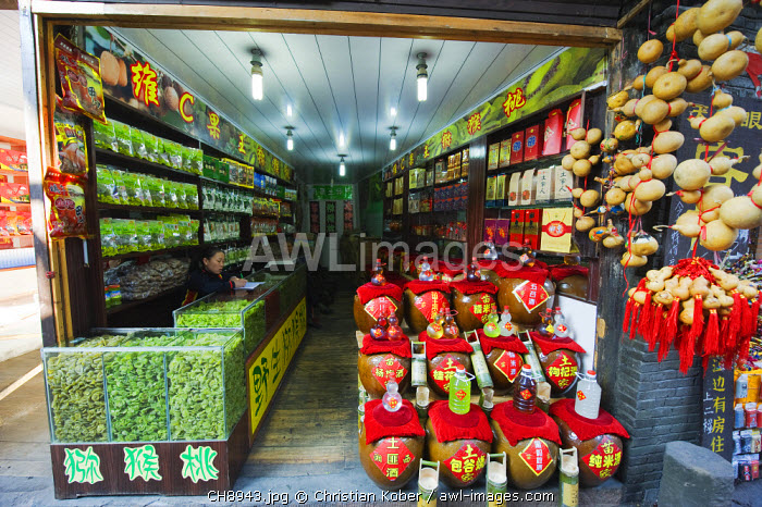 awl-images.com - China / China, Hunan Province, Fenghuang, souvenir shop selling kiwi fruit and alcohol