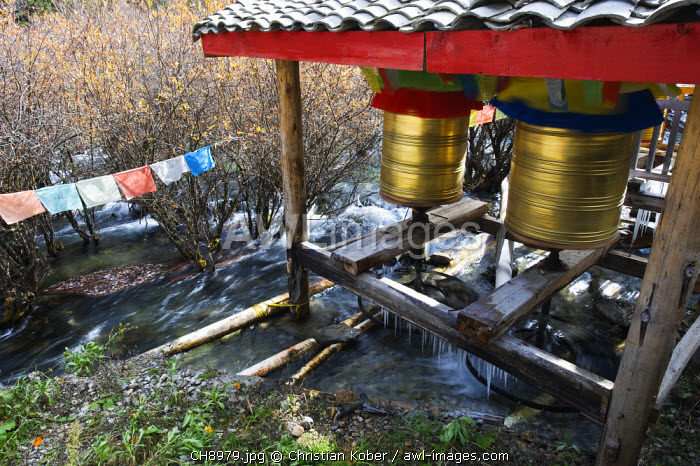 awl-images.com - China / China, Sichuan Province, Jiuzhaigou National Park, Unesco World Heritage Site, prayer wheels being turned by the flow of river water