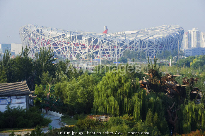 awl-images.com - China / China, Beijing, The Birds Nest Olympic Stadium, by Herzog & de Meuron, seen from the Ethnic Minorities Park