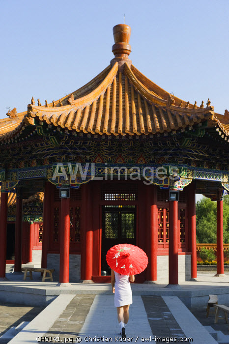 awl-images.com - China / China, Beijing, Ethnic Minorities Park, a girl with parasol at a pavilion. (MR)