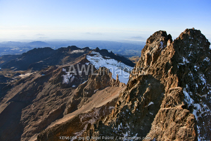awl-images.com - Kenya / Kenya. The snow-dusted twin peaks of Mount Kenya, Africa�s second highest mountain, with Point Lenana and Lewis glacier in the background.