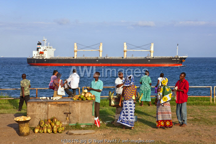awl-images.com - Kenya / Kenya, Mombasa. Food stalls along the seafront where ocean-going vessels pass to enter Kilindini Harbour.