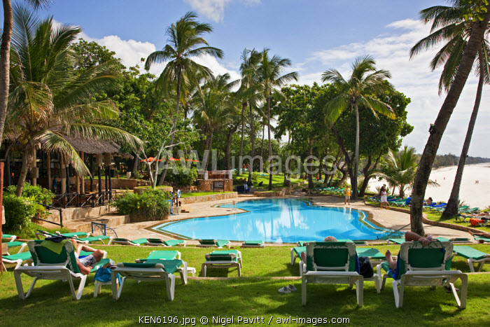 awl-images.com - Kenya / Kenya, Mombasa. The swimming pool of Baobab Resort with the white sands of Diani Beach in the background.
