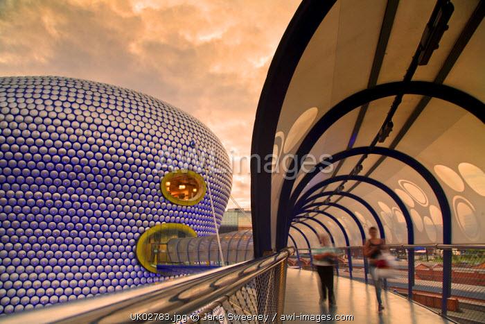 England, West Midlands, Birmingham, People walking over bridge link to Selfridges building