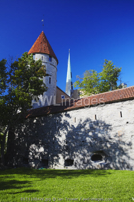Estonia, Tallinn, Tower On Town Wall With Oleviste Church In Background