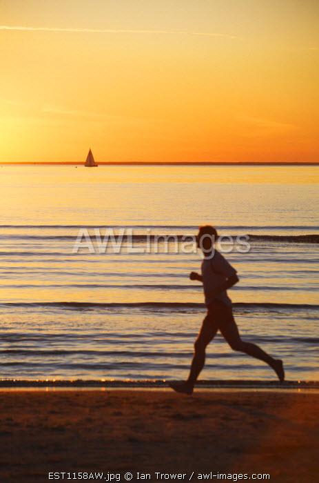 Estonia, Tallinn, Man Jogging Along Pirita Beach