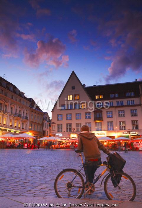 Estonia, Tallinn, Boy Sitting On Bicycle In Town Hall Square (Raekoja Plats)