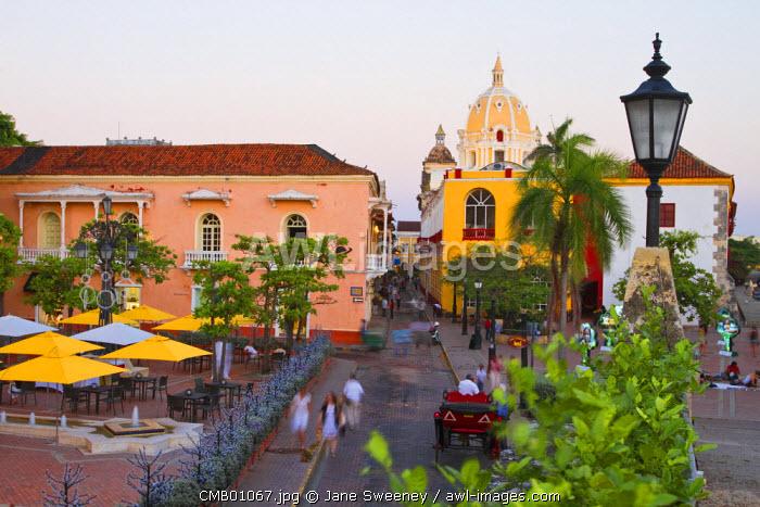 Colombia, Bolivar, Cartagena De Indias, Plaza  Santa Teresa, Horse carts going past  Hotel Charleston Cartagena  towards the Naval Museum, and San Pedro Claver Church