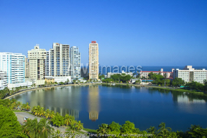 Colombia, Bolivar, Cartagena De Indias, El Laguito, Castillogrande Buildings reflecting in lagoon