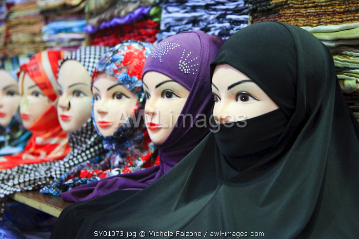 Syria, Damascus, Old Town, Souq al-Hamidiyya, mannequins with assortment of Muslim headdresses for sale