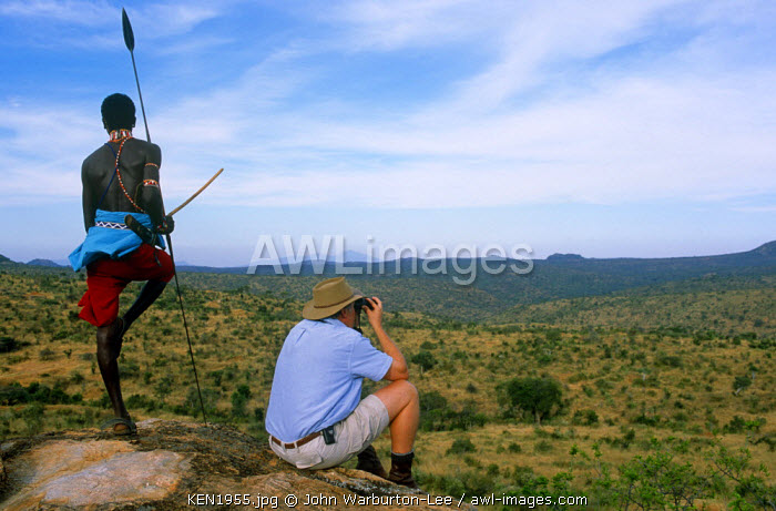 Kenya, Laikipia, Sabuk.  Looking out from a rock kopje over  the wild country of Sabuk while on a walking safari.