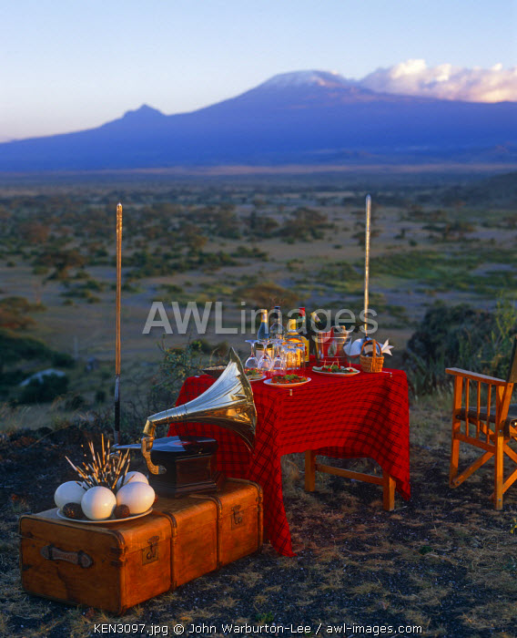 Kenya, Amboseli National Park. Sundowners in style with a view of Mount Kilimanjaro on an evening game drive from Tortilis Camp.