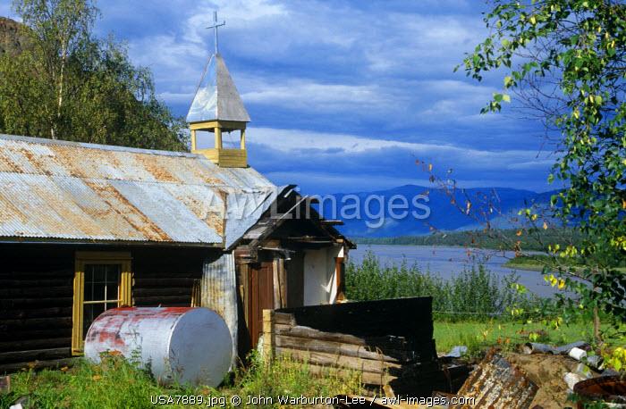 USA, Alaska.  An old log cabin church at Eagle Village on the Yukon River.