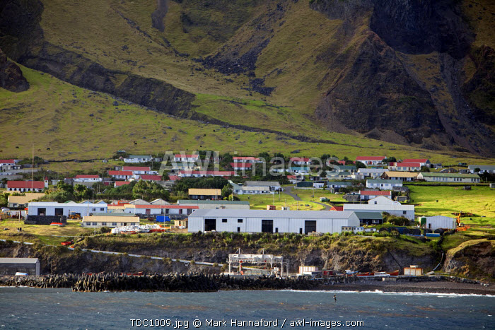 Tristan Da Cunha Island, settlement capital of Edinburgh viewed from the sea dominated by the foothills of the Queen Mary Volano.