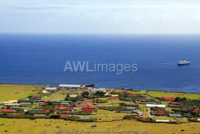 Tristan Da Cunha Island, looking down from the foothils of Queen Marys volcano over the settlement capital of Edinburgh with the cruise ship the National Geographic Explorer in the bay.
