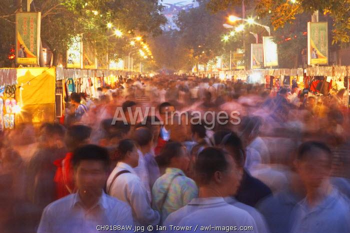 Crowds at night market, Urumqi, Xinjiang, China