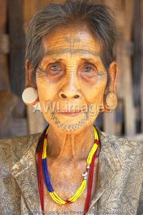 Portrait of facially tattooed woman, Bolaven Plateau, Laos