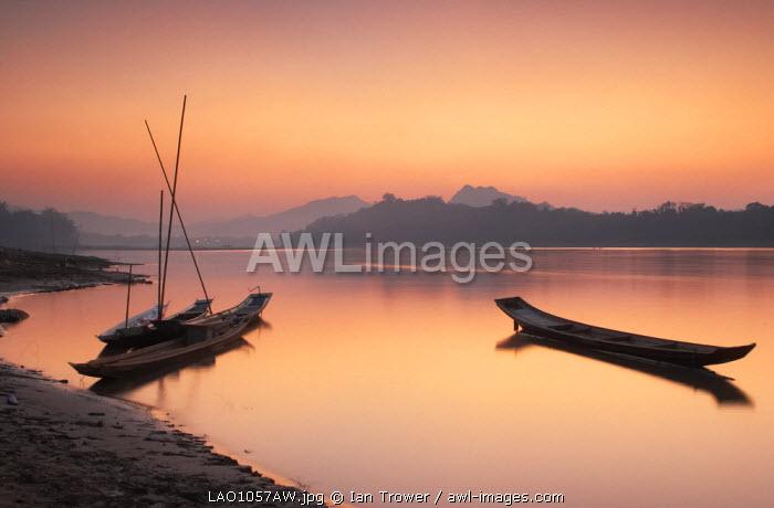 Boats on Mekong River at sunset, Luang Prabang, Laos