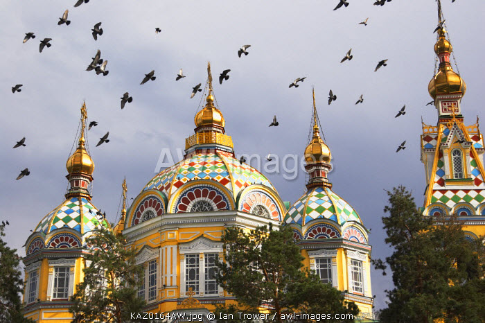 Pigeons flying over Zenkov Cathedral, Almaty, Kazakhstan