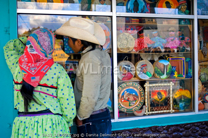 A couple window shops in downtown Creel, Mexico, a popular tourist destination and the gateway to Copper Canyon in Chihuahua State.