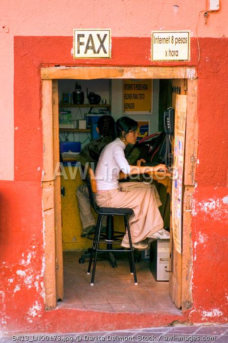 Mexico, Guanajuato. Woman in an internet cafe in downtown Guanajuato, a UNESCO World Heritage site