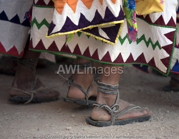Tehuerichi - Mexico. Feet of dancers celebrating Easter in Tehuerichi, a village in the Sierra Tarahumara. The sandals are made out of old tires.