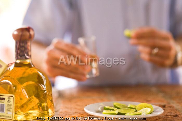men drinking, Los Osuna, Tequila Farm & Distillery (since 1876) La Noria near Mazatlan, Sinaloa State, Mexico (MR)