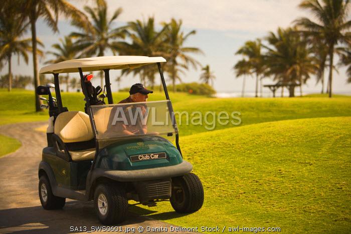 Golfers, Estella Del Mar Golf Country Club, Robert Trent Jone Jr. championship course design, Mazatlan, Sinaloa State, Mexico (MR)