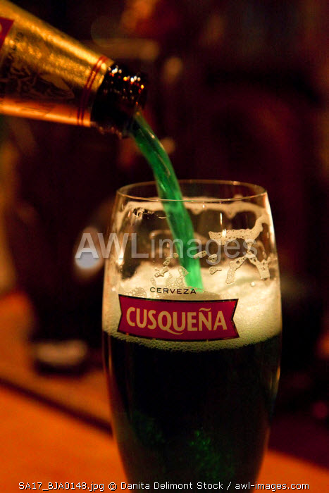 Peru, Cuzco. Pouring green Peruvian beer on St. Patrick's Day. (UNESCO World Heritate Site)