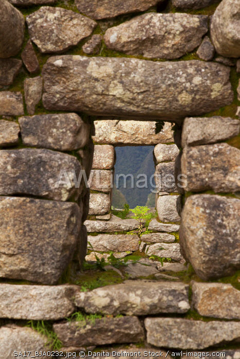 Peru, Machu Picchu. Aligned windows in stone house ruins. (UNESCO World Heritage Site)