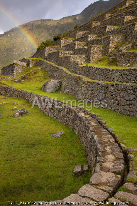 Peru, Machu Picchu. Rainbows over the agricultural terraces.  (UNESCO World Heritage Site)