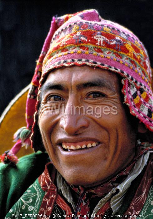 Peru, Sacsayhuaman. A man dressed in a colorful Inca costume regards the camera warmly, in Inti Raymi, near Cuzco, Peru