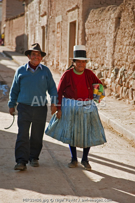 Peru, A happy couple walking down the main street of Maras, situated on a high plateau almost 11,000 ft above sea level.