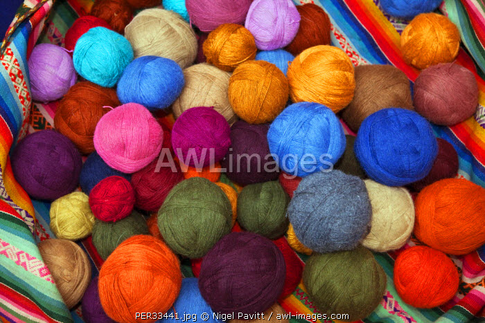 Peru, Balls of wool dyed in bright colours by Chinchero weavers using vegetable dyes in the traditional manner.