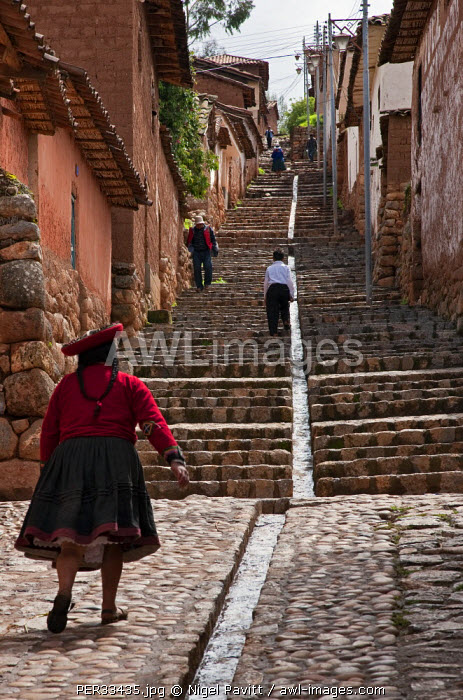 Peru, One of the steep stone pedestrian streets at Chinchero, an attractive Andean market town built on a hillside.