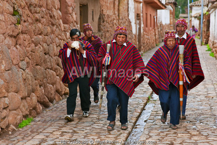 Peru, Elected community representatives, some with staffs of office in hand, one blowing a conch shell, in Chinchero