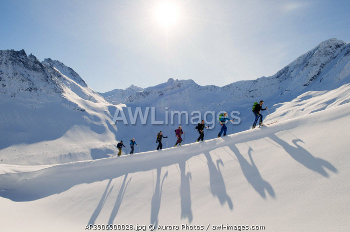 awl-images.com - Norway / Several back country skiers ski up a mountain near lesund, Norway.