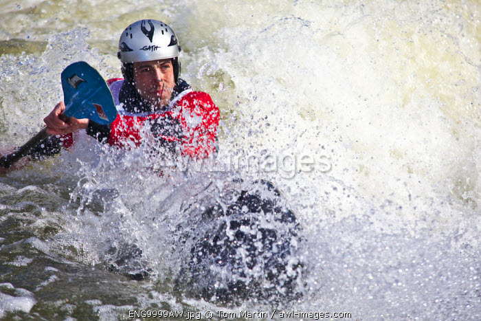 awl-images.com - England / Nottingham, UK. A Kayaker surfs on a standing wave at Holme Pierpoint, the national watersports centre.