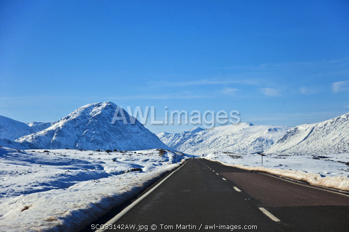awl-images.com - Scotland / Glen Coe, Scotland. Snow covers the picturesque Glen Coe, with Buachaille Etive Mor - Stob Dearg in the background and the A82 in the foreground.