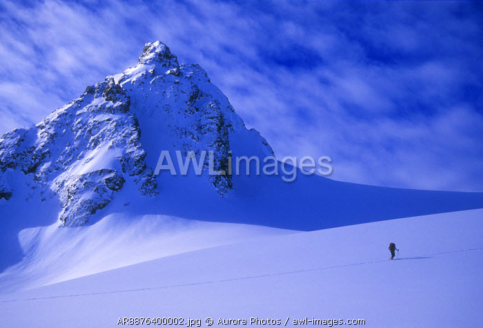 awl-images.com - Norway / A woman ski tours and explores the mountains of the Lyngen Alps in Norway