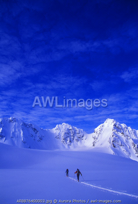 awl-images.com - Norway / A man and woman ski tour and explore the mountains of the Lyngen Alps in Norway
