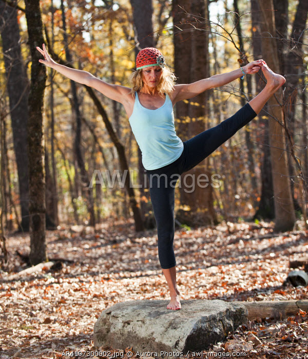 awl-images.com - USA / A woman doing yoga postures in outdoor setting