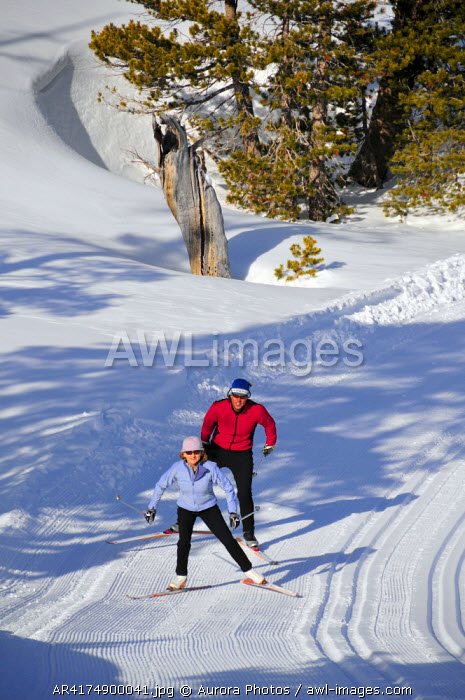 awl-images.com - USA / A man and woman cross country ski at Kirkwood Mountain Resort, California, USA