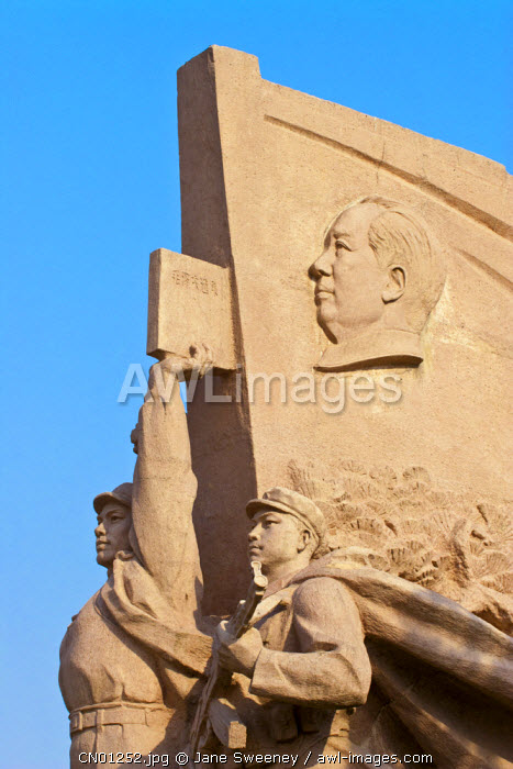 awl-images.com - China / China, Beijing, Tiananmen Square, Chairman Mao and the thoughts of Chairman Mao red book on sculpture near the Mausoleum of Mao Zedong