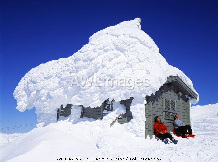 awl-images.com - Sweden / Snow pile on cabin, Sweden