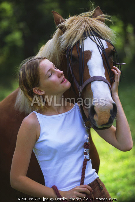 awl-images.com - Sweden / Young woman with her horse,