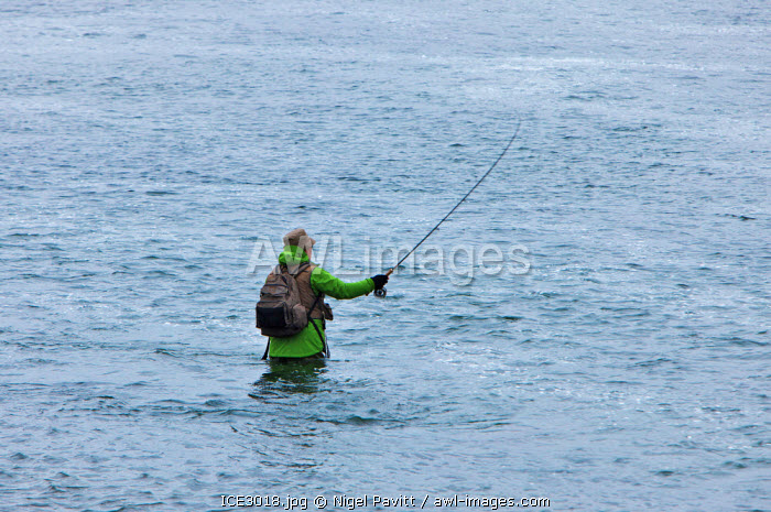 awl-images.com - Iceland / A fisherman fishing for salmon in the Laxardalur River, south of Husavik.